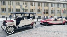 Vintage cars line the street