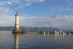 Lindau Lighthouse with the Alps in the background